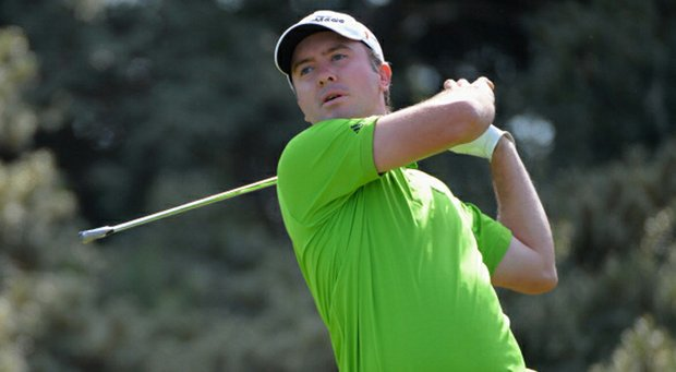 Martin Laird hits his tee shot on the third hole during the third round of the Open Championship at Muirfield.