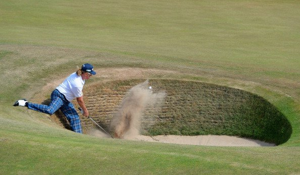 Miguel Angel Jimenez plays out of a bunker on the fourth hole during the third round of the Open Championship