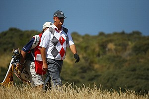 Sandy Lyle walks after teeing off during the third round of the Open Championship at Muirfield.