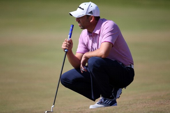 Sergio Garcia lines up a putt on the third green during the third round of the 2013 Open Championship.