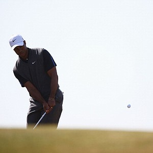 Tiger Woods chips on the seventh during the third round of the Open Championship at Muirfield.