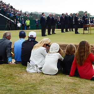 Manager Steve Loy, caddie Steve MacKay, coach Butch Harmon and the Mickelson family watch Phil Mickelson give his acceptance speech after winning the Claret Jug.