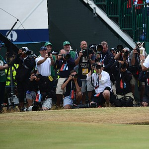 Phil Mickelson poses with the Claret Jug for the plethora of photographers from around the world.