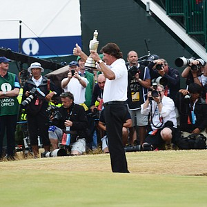 Phil Mickelson poses for the cameras after winning the Claret Jug on Sunday at Muirfield.