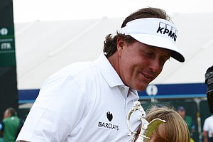Phil Mickelson embraces his son, Evan, after winning the Open Championship at Muirfield on Sunday.