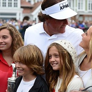 Phil Mickelson and his family stop for pictures after Mickelson won the 2013 Open Championship.