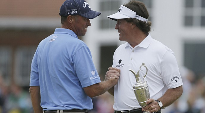 Phil Mickelson with caddie Bones Mackay (left) on Sunday after winning the 2013 British Open at Muirfield.
