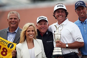 Phil Mickelson poses with his coach Butch Harmon (center), manager Steve Loy (left), caddie Jim Mackay (righ) and wife Amy after winning the 2013 Open Championship at Muirfield.