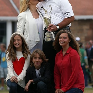 Phil Mickelson poses for pictures with his wife Amy (top left) and children Evan Samuel, Amanda Brynn and Sophia Isabel after winning the 2013 Open Championship at Muirfield.