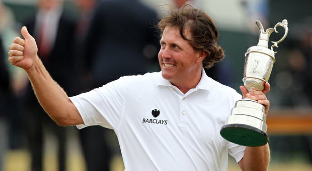 Phil Mickelson poses for pictures with the Claret Jug after winning the 2013 Open Championship at Muirfield.