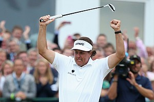 Phil Mickelson reacts to a birdie putt on the 18th hole during the final round of the 142nd Open Championship at Muirfield.