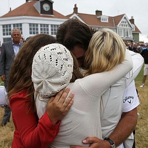 Phil Mickelson hugs wife Amy and children Evan, Amanda and Sophia after finishing the final round of the 142nd Open Championship at Muirfield.