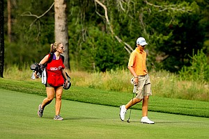 Sam Burns walks up the 11th fairway with his sister/caddie, Tori, during the 66th U. S. Junior Amateur Championship at Martis Camp Club.