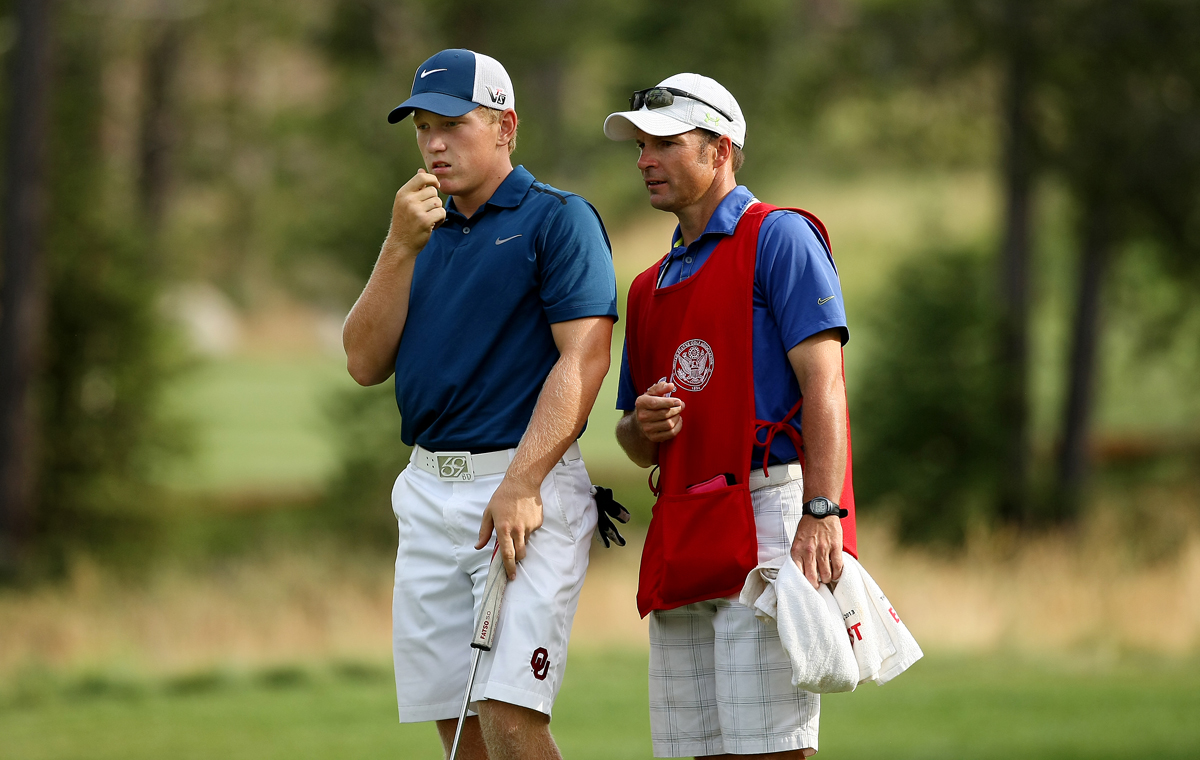 Brad Dalke and his caddie Frank Capan during the 66th U. S. Junior Amateur Championship at Martis Camp Club.