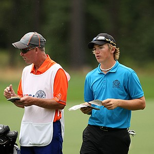 Sam Horsfield, right, confers yardage with his caddie, Jason Bell, at No. 1 during the final day of stroke play at the 66th U. S. Junior Amateur Championship at Martis Camp Club.
