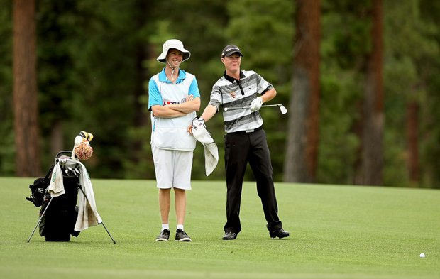 Sean Crocker with his caddie A. J. Hopkins waits to hit his shot at No. 9 during the final day of stroke play at the 66th U. S. Junior Amateur Championship at Martis Camp Club. Crocker posted a two-day total of 146.