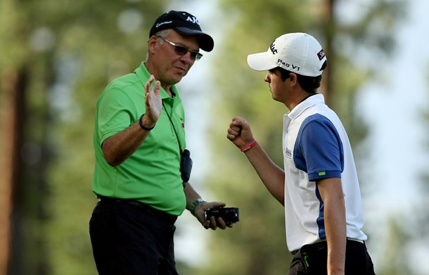 Jorge Antonio Garcia with his dad, Jorge, after coming off the last hole during the final day of stroke play at the 66th U. S. Junior Amateur Championship.