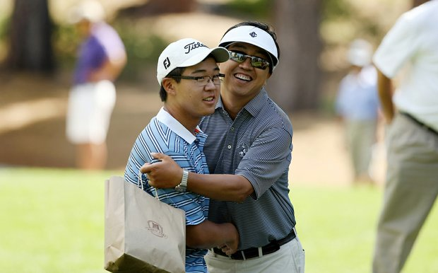 Jim Liu's father, Yiming Liu, congratulates his son after 19-holes of match play during the Round of 64 at the 66th U. S. Junior Amateur Championship. Liu defeated Matthew Lowe in 19 holes.