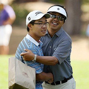 Jim Liu's father, Yiming Liu, congratulates his son after 19-holes of match play during the Round of 64 at the 66th U. S. Junior Amateur. Liu defeated Matthew Lowe.