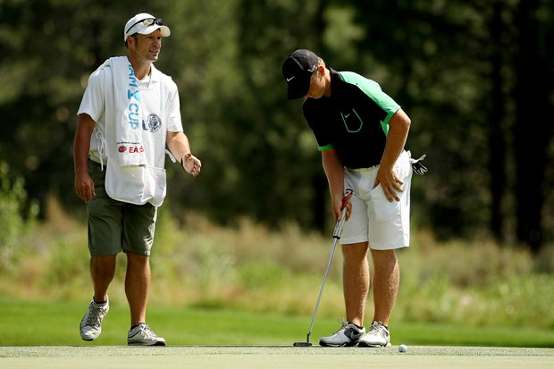 Brad Dalke's caddie Frank Capan helps him with his putt at No. 11 during the Round of 64.