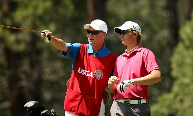 Sam Horsfield confers with his caddie Jason Bell at No. 12 during the Round of 64. Horsfield won his match 7 and 6.