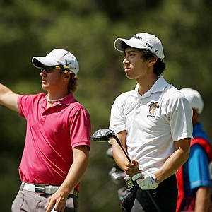 Dean Sakata watches his tee shot at No. 12 as Sam Horsfield signals his shot right during the Round of 64 at the 66th U. S. Junior Amateur.