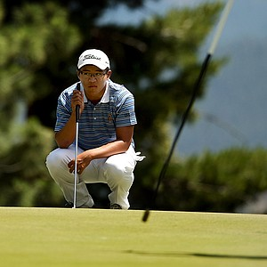 Jim Liu watches Matthew Lowe as he prepares to putt at No. 9 during the Round of 64. Liu defeated Lowe in 19 holes.