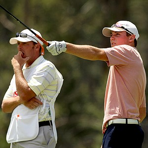 Trevor Phillips talks with his caddie, pro golfer, Tommy Biershenk at No. 12 during the Round of 64 at the 66th U. S. Junior Amateur. Phillips defeated William Register 4 and 3.