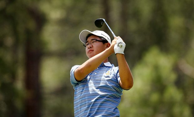 Jim Liu watches his tee shot at No. 12 during the Round of 64 at the 66th U. S. Junior Amateur Championship.
