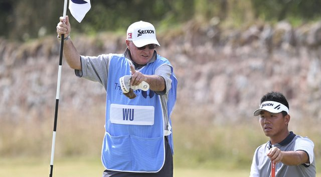 Andy Prodger, former caddie for Nick Faldo, with Ashun Wu during the 2013 British Open at Muirfield.