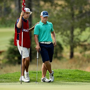 Alvaro Ortiz caddied for Brad Dalke in the Round of 32 after losing to him in the Round of 64, at the 66th U. S. Junior Amateur Championship. Dalke lost to Brian Carlson.