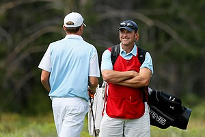 Pro golfer Tommy Biershenk is providing a bit of knowledge to his player Trevor Phillips during the Round of 32 at the 66th U. S. Junior Amateur. Phillips won 3 and 2 over Daniel Connolly.