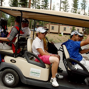 Sam Horsfield and Aaron Terrazas are carted back to the clubhouse after the horn sounded for a weather delay during the Round of 16 at the 66th U. S. Junior Amateur Championship.