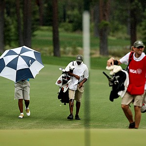 Zecheng Dou walks up the fairway at No. 11 during the Round of 16 at the 66th U. S. Junior Amateur Championship. A second rain delay for the day was called.