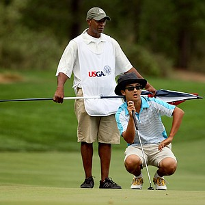 Zecheng Dou lines up his putt at No. 11 with his caddie Scotty Wyckoff during the Round of 16 at the 66th U. S. Junior Amateur Championship.