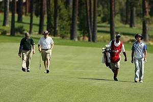 Zecheng Dou walks down the 11th fairway during the quaterfinals at the 66th U. S. Junior Amateur.