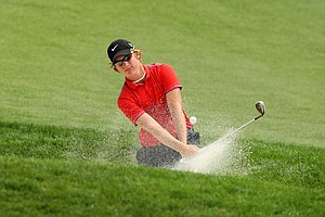 Sam Horsfield hits out of the bunker at No. 16 during the quarterfinals at the 66th U. S. Junior Amateur.