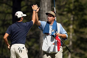 "Davis Riley high fives his caddie ""Binky"" during the semifinals at the 66th U. S. Junior Amateur Championship."