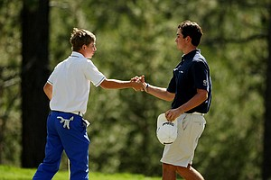 John Augenstein shakes hands wityh Davis Riley after their semifinal matach at the 66th U. S. Junior Amateur Championship.