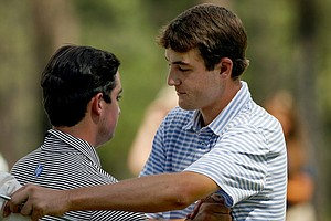 Scottie Scheffler shakes hands with Davis Riley after winning 3 and 2 during the finals of the 66th U. S. Junior Amateur Championship.