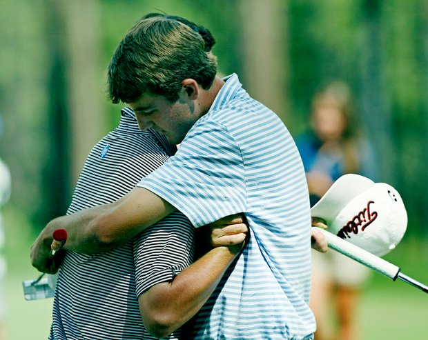 Scottie Scheffler shakes hands with Davis Riley after winning 3 and 2 during the finals of the 66th U. S. Junior Amateur Championship at Martis Camp Club.