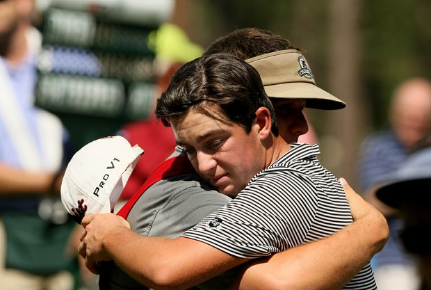 Caddie Christiano DiPasquale tries to console Davis Riley after he called a penalty on himself on the last hole during the finals of the 66th U. S. Junior Amateur Championship.