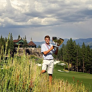 Scottie Scheffler holds the U. S. Junior Amateur trophy after defeating Davis Riley, 3 and 2, during the finals of the 66th U. S. Junior Amateur Championship at Martis Camp Club.