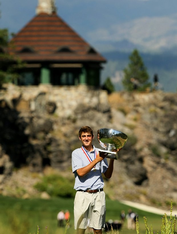 Scottie Scheffler holds the U. S. Junior Amateur trophy after winning 3 and 2 during the finals.