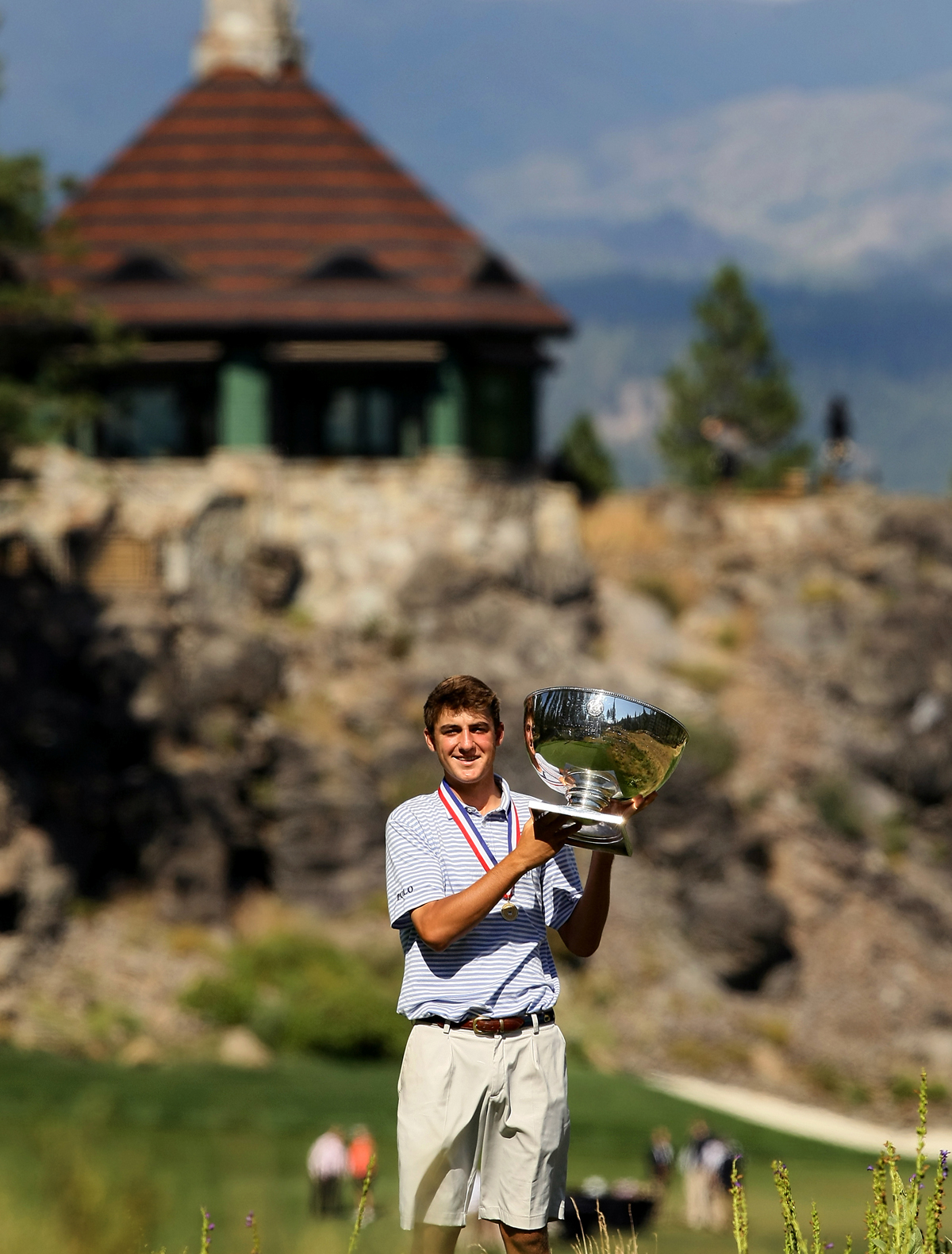 Scottie Scheffler holds the U. S. Junior Amateur trophy after winning 3 and 2 during the finals.
