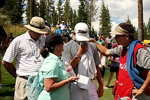 Davis Riley is consoled by his parents and his caddie, Christian DiPasquale, during the finals of the 66th U. S. Junior Amateur Championship at Martis Camp Club.