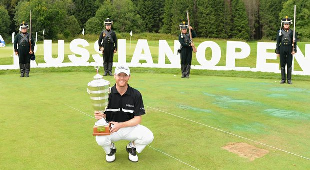 Michael Hoey celebrates with the trophy after winning the M2M Russian Open at Tseleevo Golf & Polo Club.