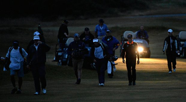 Bernhard Langer and Mark Wiebe make their way onto the 18th green for the second playoff hole during the final round of the Senior Open Championship at Royal Birkdale.