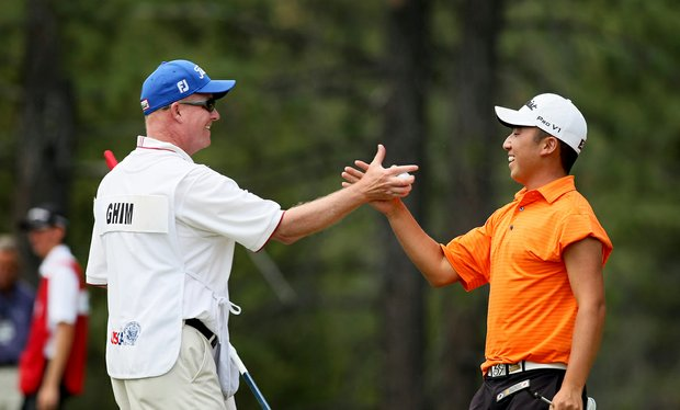 Doug Ghim celebrates winning his match at No. 15 during the quarterfinals at the 66th U. S. Junior Amateur.
