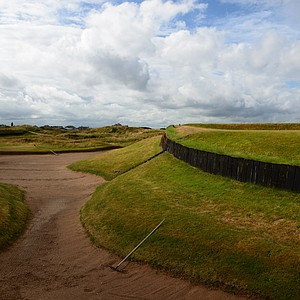 A mistake on the third hole can find this bunker, cavernous and capable of making a round miserable.